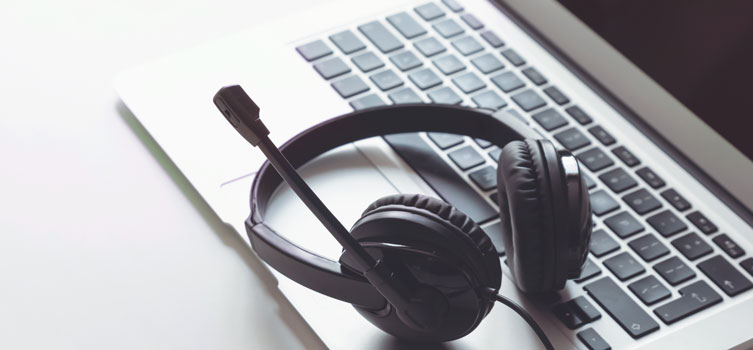 close up of microphone headset resting on a laptop